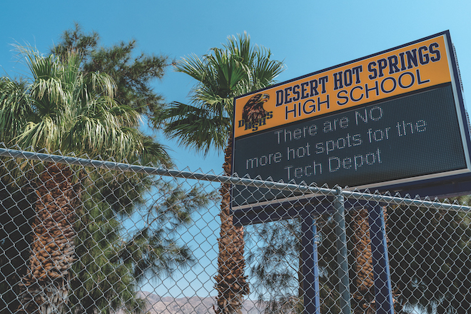 A sign outside of Desert Hot Springs High School notifies parents and students that they have run out of hotspots.